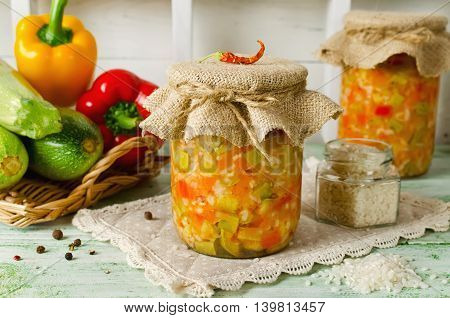 Rice with vegetables - zucchini paprika and onions. Home canning