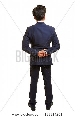 Business man from behind with his hands behind his back
