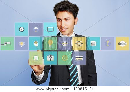 Business man pushing virtual brain icon button on a touchscreen