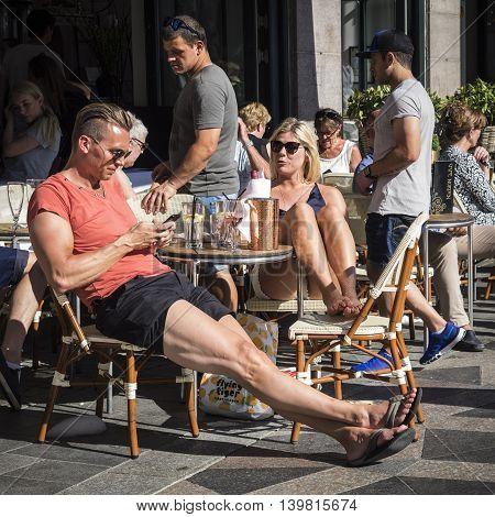COPENHAGEN, DENMARK - JULY 27: Yong couple sitting in a restaurant in Copenhagen at July 27, 2016
