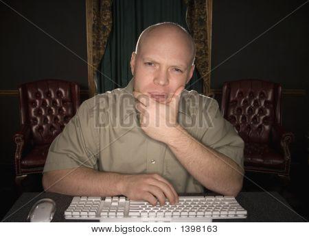 Thinking Man Looking At Computer