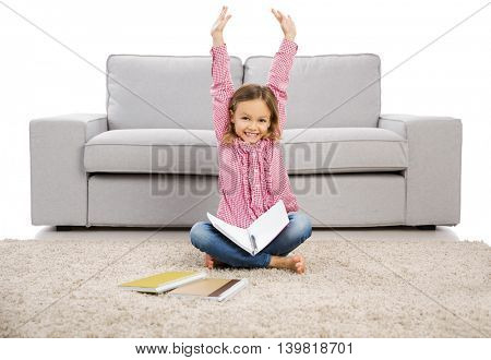 Cute little girl at home studying