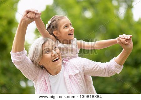 Grandmother with her granddaughter in summer  park