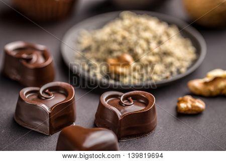 Chocolate hearts on black background, studio shot