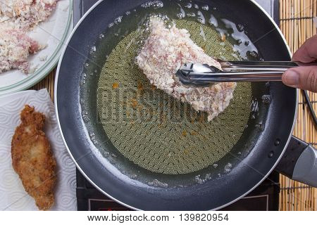 Chef deep fried pork in pan / cooking Japanese pork curry paste concept