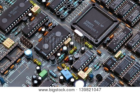 Printed circuit board with electrical components lying on construction  electronics  engineer technology computer