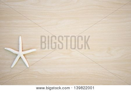 Beautiful Star fish on wooden background, Thailand