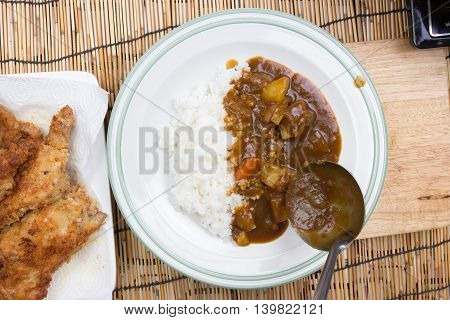 Chef shovel Japanese pork curry with steam rice / cooking Japanese pork curry paste concept