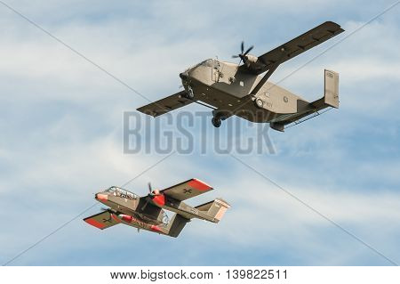 FARNBOROUGH, UK - JULY 18: Short SC7 Skyvan and a vintage Rockwell OV-10 Bronco light attack aircraft on take-off from Farnborough, UK on July 18, 2016