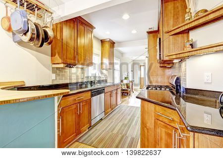 Narrow Kitchen Room Interior With Cabinets And Granite Tops.