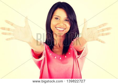Young woman showing her hands palm