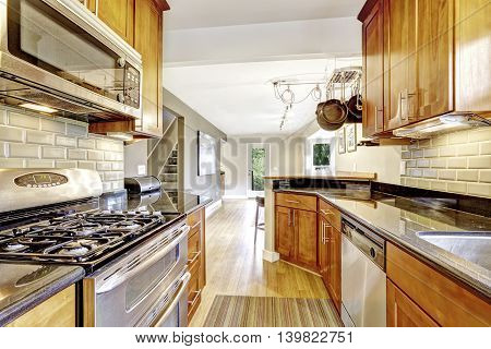 Narrow Kitchen Room Interior With Cabinets And  Steel Appliances.