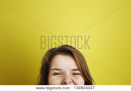 Young Girl Playing Face Expression Concept