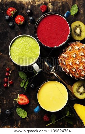 glasses of various smoothies with straws and fruits. Healthy breakfast, vegetarian or raw eating concept
