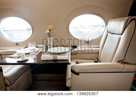 Outside view in aircraft window, business jet flight