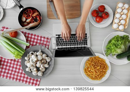 Woman cooking on kitchen. Food blog concept, top view