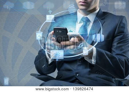 Man with mobile phone in cloud computing concept