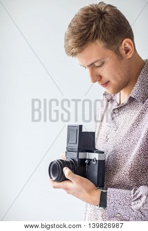 Portrait Of Handsome Man With Old Medium Format Camera