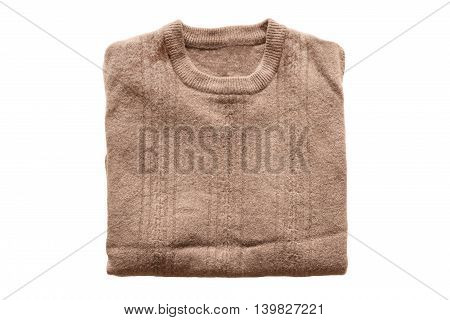 Folded brown wool sweater on white background