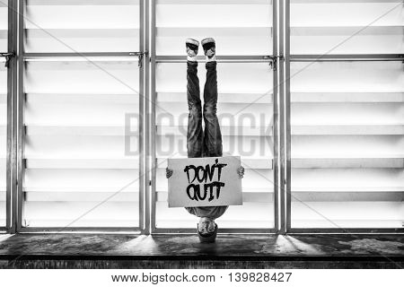 Man Holding Speech Sign Don't Quit Concept