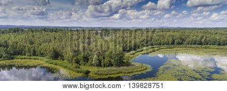 Summer Time Lake And Green Forest, White Clouds Over Blue Sky In Poland Lanscape.