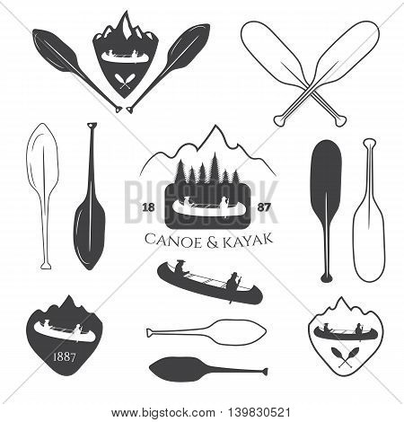 Set of vintage mountain rafting kayaking paddling canoeing camp logo labels and badges. Illustration in vector.
