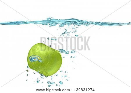 Fresh green apple falling in water on white background