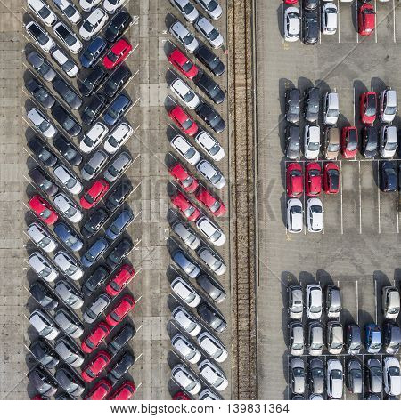 Aerial View Lot Of Vehicles On Parking For New Car.