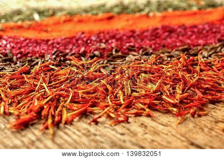 Different spices on wooden background, close up