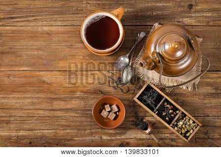 Tea ceremony: various kinds of tea teapot and tea cup. Top view on a old wooden table with copy space.