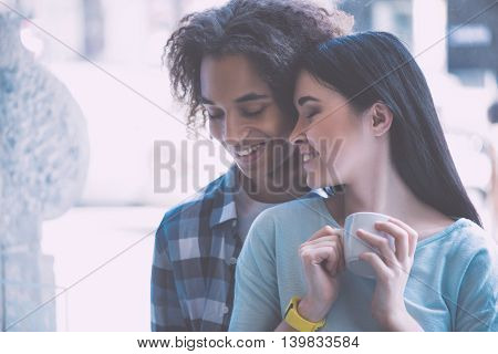My love. Close up of positive and lovely young couple being very romantic
