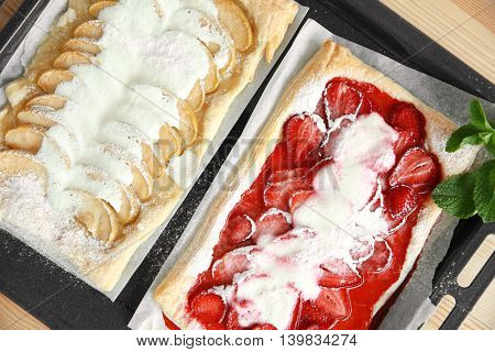 Baked strawberry and apple desserts in oven tray