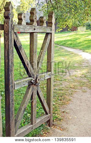 Vintage wooden rural gate in garden Pereiaslav-Khmelnytskyi Ukraine