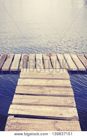 Vintage Toned Old Wooden Pier By A River