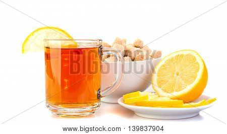 cup of black tea with lemon slices of lemon on the saucer brown sugar. Isolated on white background.