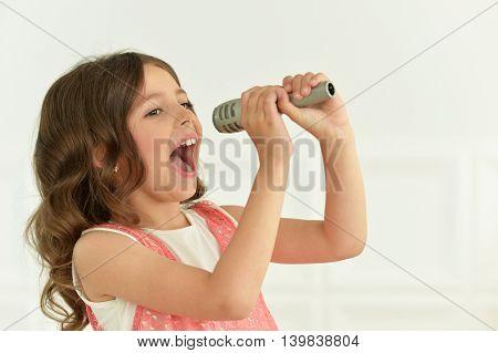 portrait of cute little girl  in beautiful dress singing