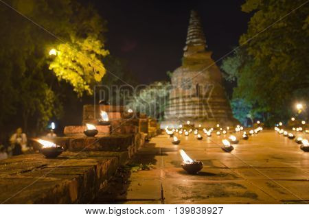 Series of candle light around Buddha pagoda temple in Wat Maheyong Ayutthaya Thailand