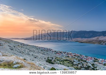 Aerial view on Island of Pag in sunset summertime, touristic destination in Croatia, with town of Pag in downtown.