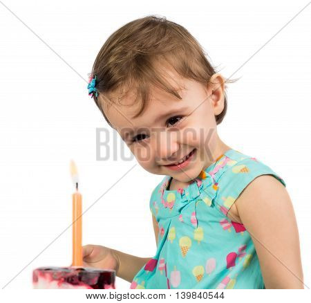 Cute smiling baby girl with cake and candle isolated on white background
