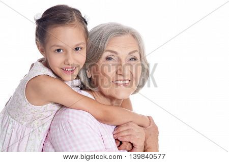 Grandmother with her cute  granddaughter on white background