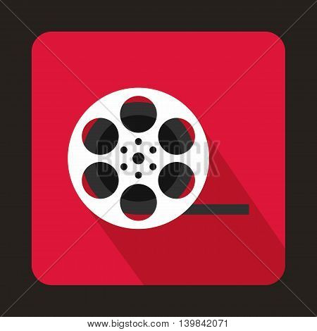 Film reel icon in flat style on a pink background