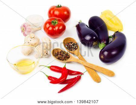 Food ingredients: eggplant tomato pepper mushroom salt isolated on white background