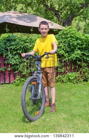 boy on bike in summer day