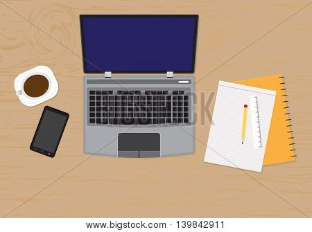 top view of desk with laptop, digital devices, office objects, books and documents with long shadows