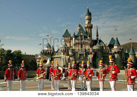 Hong Kong China - December 13 2005: Hong Kong Disneyland marching band and the Sleeping Beauty Castle