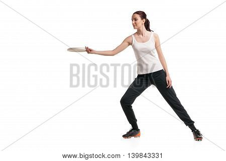 picture of young happy woman playing with flying disc over white background