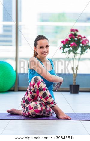 Young woman doing exercises in gym health concept