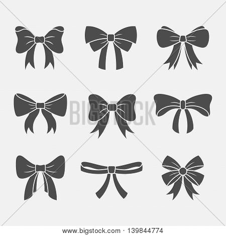 Bows with ribbons vector set isolated from the background. Dark silhouettes of gift or holidays bows and knots. Simple icons packaging decorative bows in a flat style.