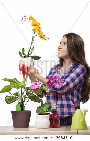Young woman taking care of home plants