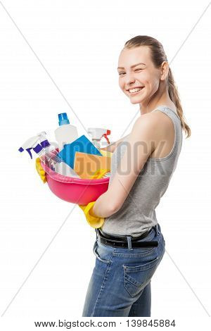Smiling and winking young woman with bowl of cleansers and wipes, close-up, housewife, isolated on white
